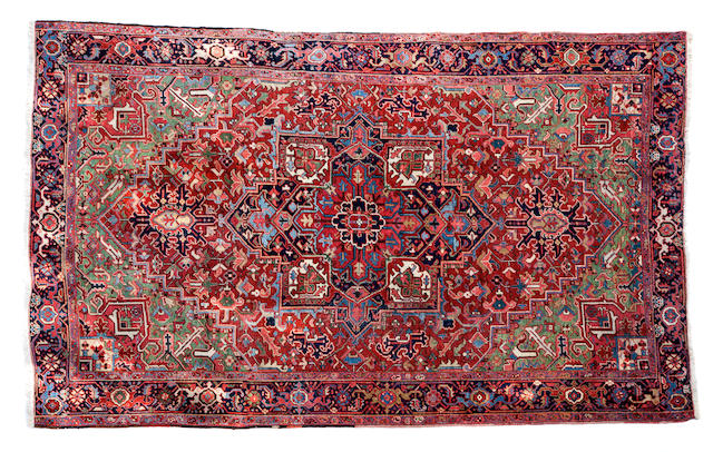 A Heriz carpet size approximately 8ft. 1in. x 3ft. 1in.