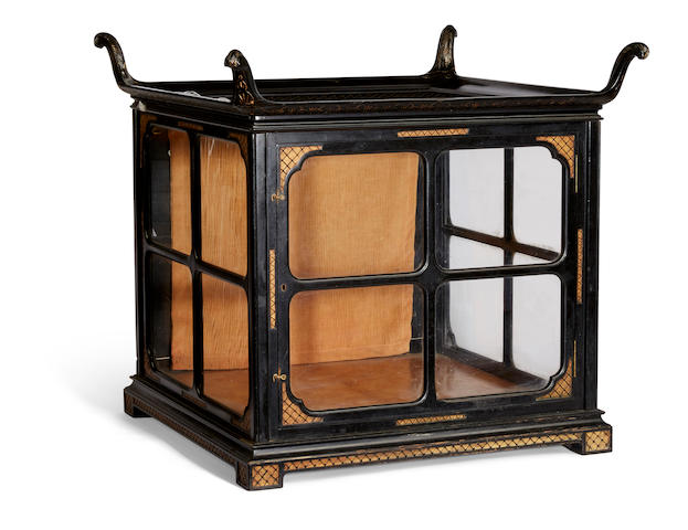 A Rare and Unusual American parcel gilt and ebonized wood dog display case