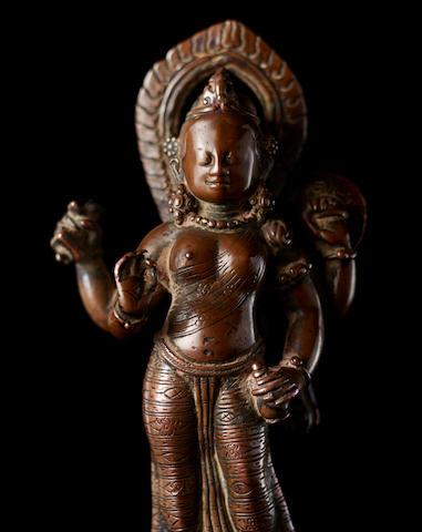A copper figure of Devi Nepal, circa 9th century