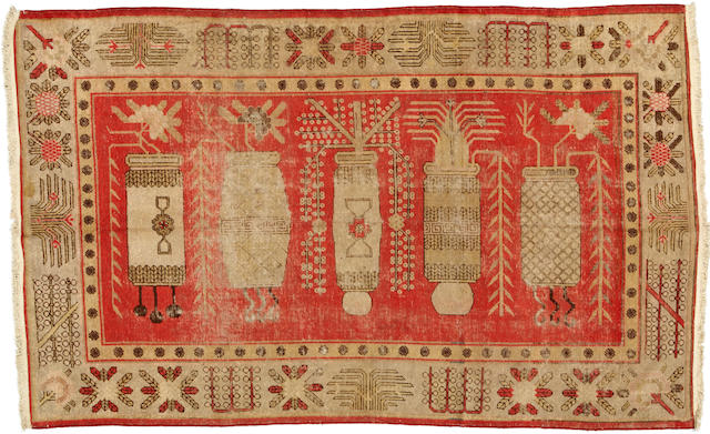 A Khotan rug size approximately 5ft. 5in. x 9ft.