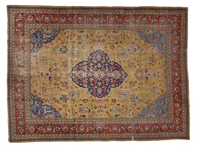 A Tabriz carpet  size approximately 9ft. 11in. x 13ft. 6in.
