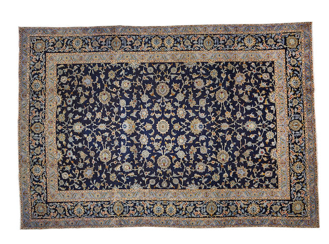 A Kashan carpet  size approximately 7ft. 11in. x 11ft.