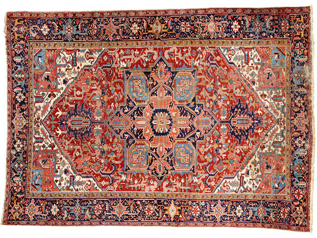 A Heriz carpet  size approximately 9ft. 1in. x 12ft. 9in.