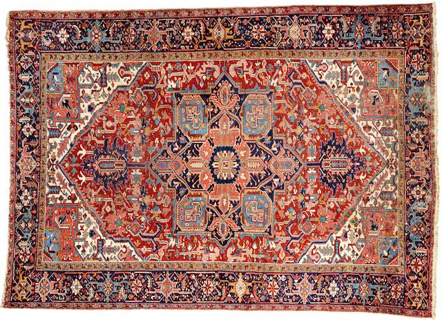 A Heriz carpet  size approximately 9ft. 1in. x 12ft. 9in.