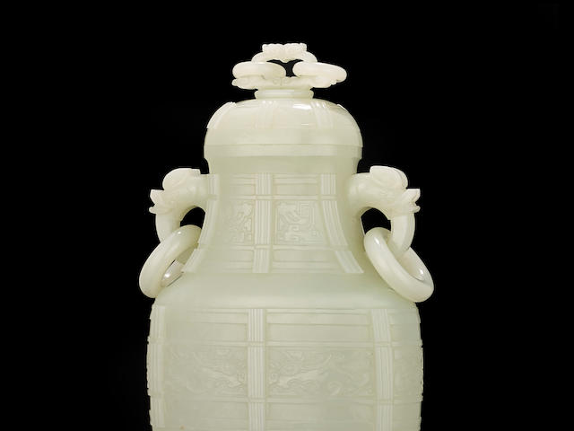 A fine very pale green jade archaistic vase and cover  Qianlong period