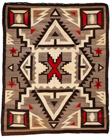 A Navajo rug size approximately 5ft. 4in. x 6ft. 8in.