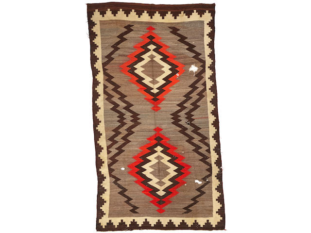 A Navajo rug size approximately 6ft. 2in. x 11ft. 3in.
