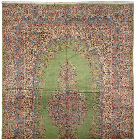 A Kerman carpet size approximately 13ft. 8in. x 21ft. 5in.