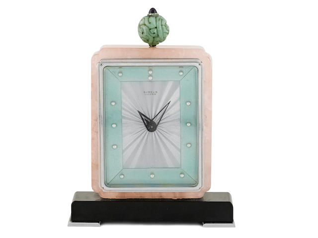 A Swiss  rose quartz, jadeite, amethyst and hardstone  Art Deco 'Chinoiserie' eight-day clock retailed by Maison Gübelin, Lucerne,  circa 1930