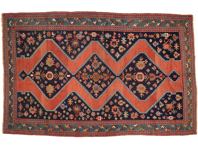 A Caucasian rug  size approximately 5ft. 11in. x 9ft. 2in.