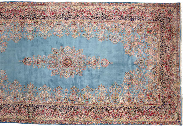 A Kerman carpet  size approximately 11ft. 2in. x 21ft. 6in.