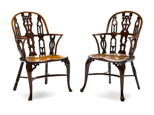 A near pair of George III yew and elm Windsor armchairs fourth quarter 18th century