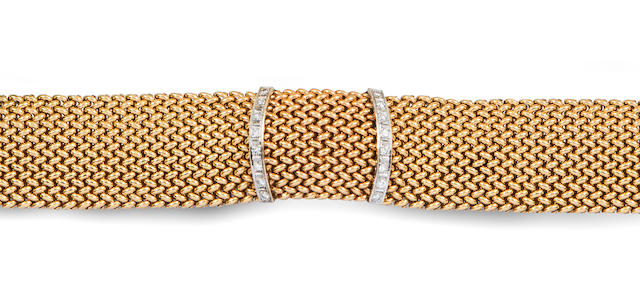 A 14k gold and diamond covered dial wristwatch