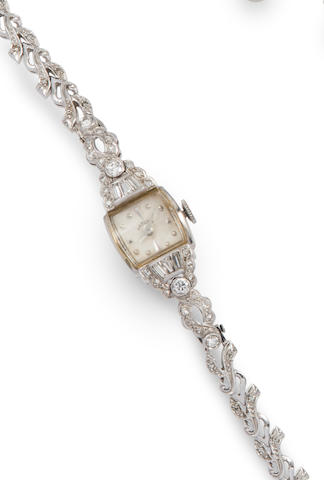 A diamond and 14k white gold lady's wristwatch, Hamilton