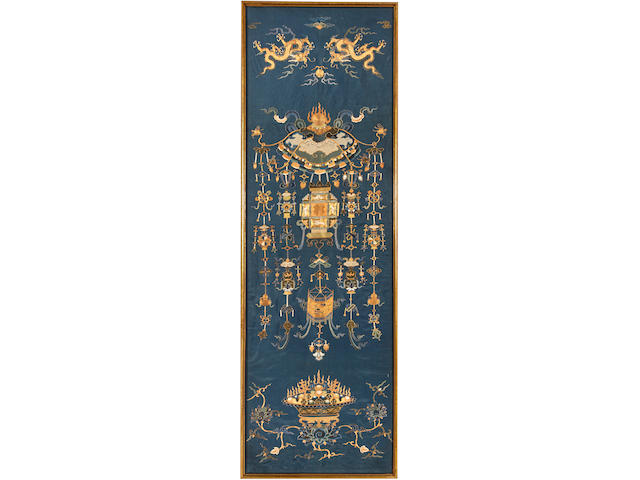 A blue silk ground vertical panel embroiderd in gilt-wrapped threads 19th century