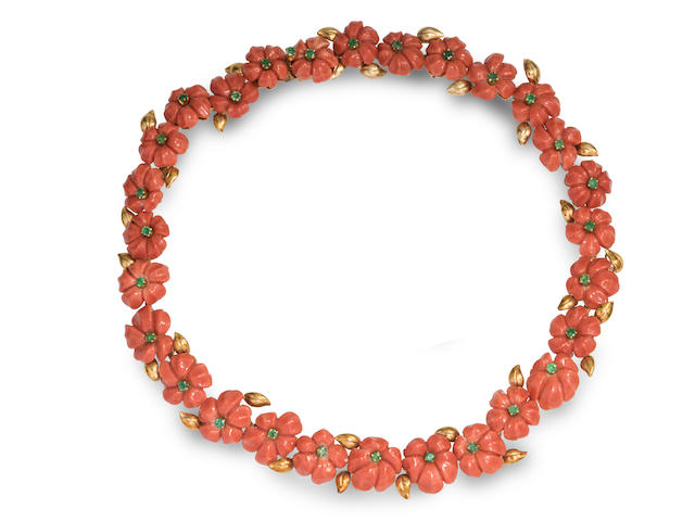 A carved coral, emerald and 18k gold flower necklace, Trio