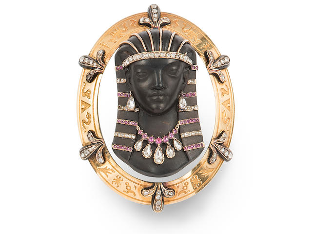 An Egyptian revival hardstone cameo, diamond, ruby and 18k gold brooch, French,