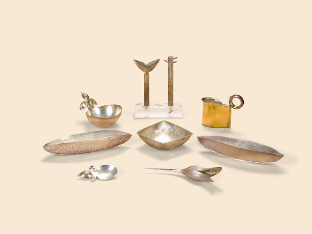 Modern Craft Group of sterling silver articles, late 20th/early 21st centuriescomprising a Jack da Silva 18kt gold washed sterling creamer, 2003, a Mexican silver sugar bowl & scoop, a silver Duck spoon, two leaf form dishes, a Barbara Bayre square dish, a tree-form salt and pepper on acrylic stand, signed Spring Buties 925, together with a mixed metal and 'jeweled' magnifying glass and letter openerheight of creamer 3 1/4in (8cm); length of dishes 4in (10cm) to 7 1/2in (19cm)
