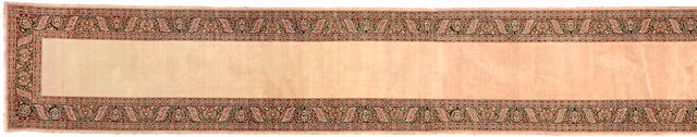 A Tabriz runner Northwest Persia size approximately 2ft. 10in. x 28ft. 4in.