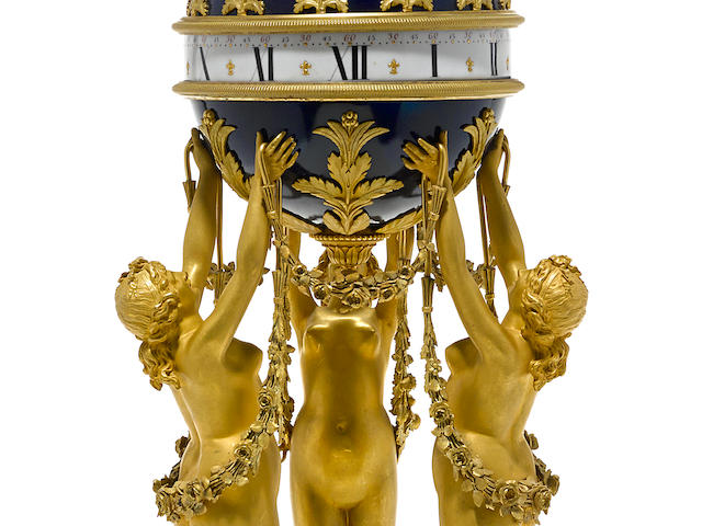 A good quality French gilt bronze mounted enamel and marble rotary clock late 19th century