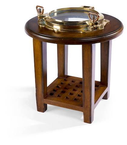 A porthole table 28 X 23-1/2 in., height X diameter.