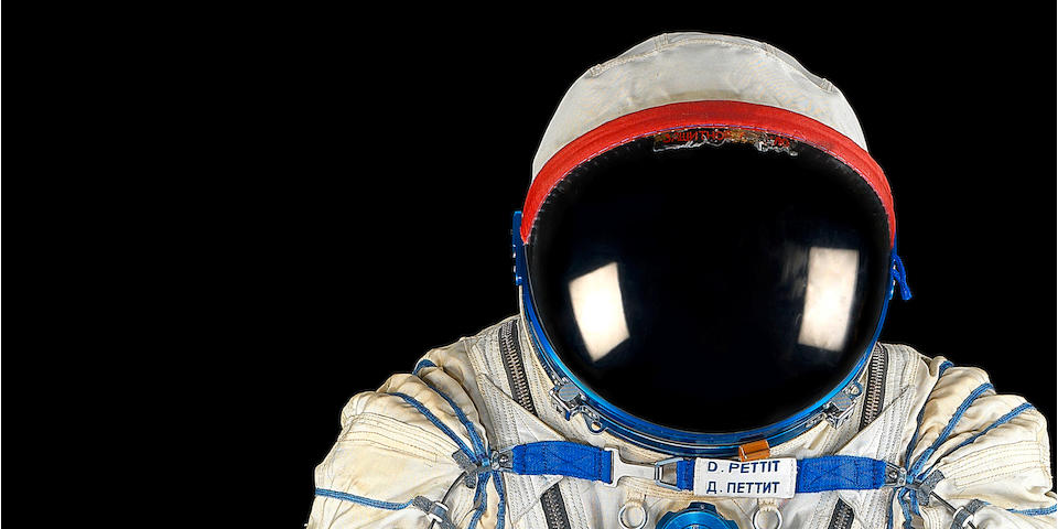 FLOWN SPACE SUIT FROM ISS EXPEDITION 6 SPACE SUIT WORN BY FLIGHT ENGINEER DON PETTIT ON HIS DRAMATIC RETURN TO EARTH ABOARD THE SOYUZ TMA-1, FOLLOWING THE COLUMBIA DISASTER