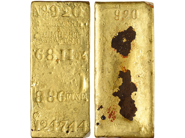 Kellogg & Humbert Gold Ingot, No. 920, 68.11 oz, .886 Fine, $1247.44 Face Value CAGB - 687. 98mm x 42mm x 30mm. A beautiful and highly important example from the greatest gold treasure ever found. Rich yellow-gold overall with some deep russet-brown scale on the back as is seen on many of the ingots recovered from the S.S. Central America. Cast as a rectangle almost four inches in length and two inches wide (slightly longer than a standard credit card). Face: No. 920 / 68.11 Oz. / 886 FINE / $1247.44 on four lines with the KELLOGG & HUMBERT ASSAYERS logo in a rectangle between lines one and two. The viewer's lower right corner was taken for assay reasons. Back: 920 at top, typical casting indentation at the center caused by shrinkage of the metal when it cooled in the mold, upper viewer's right corner taken for assay purposes. A very pleasing example of these sometimes hefty ingots, this one small enough to fit comfortably in one's hand.