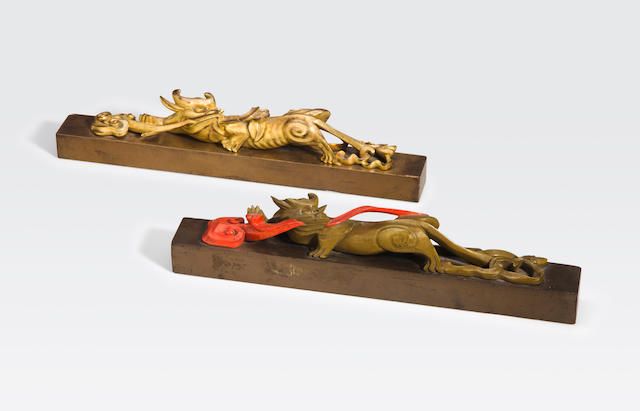 A two lacquered scroll weights