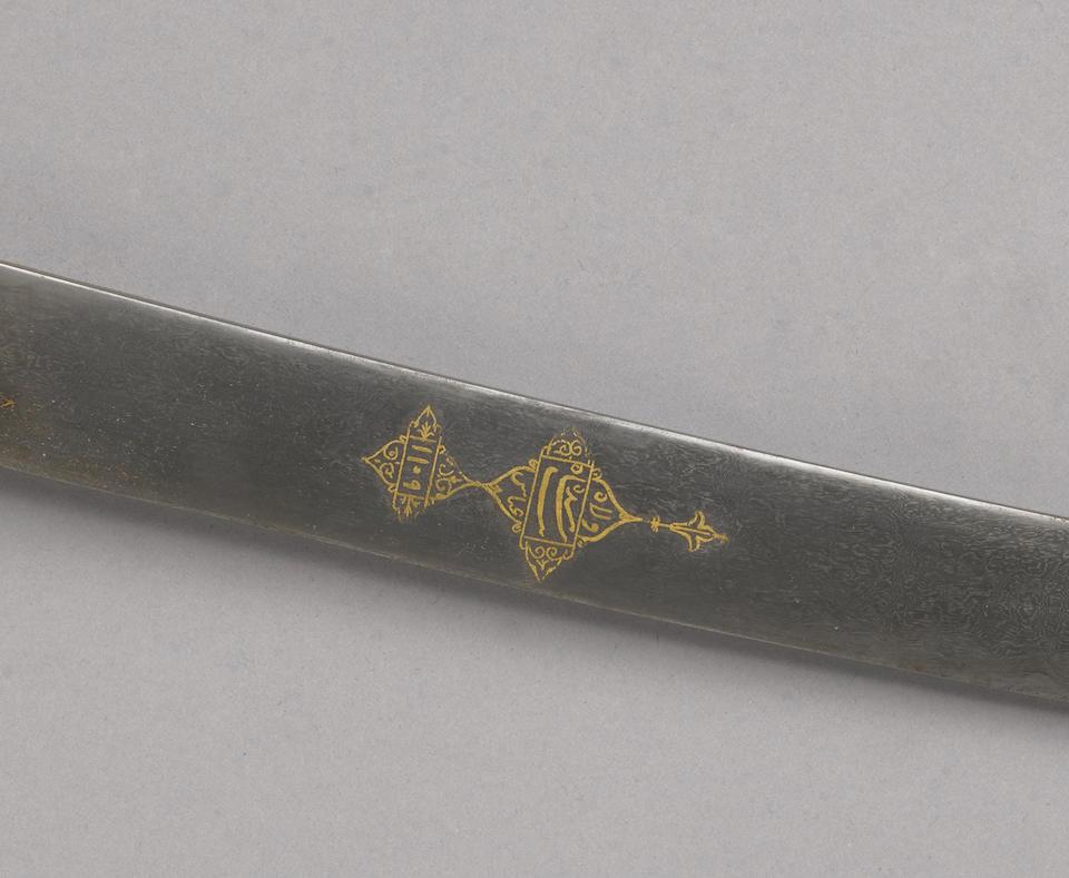 A fine gem-set and parcel-gilt silver hilted Indian saber