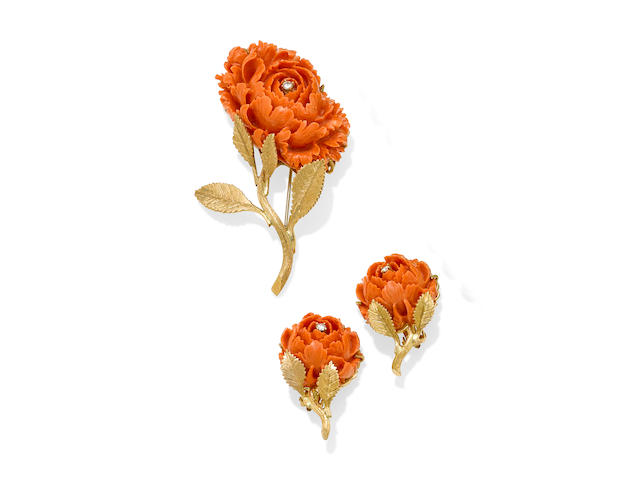 A carved coral, diamond and gold rose brooch and ear clip set