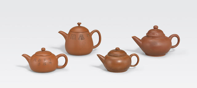 A group of four miniature Yixing teapots