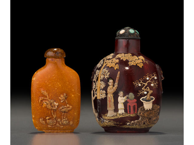 An embellished amber snuff bottle and a carved baltic amber snuff bottle Embellished bottle: 1850-1930, embellishment: Tsuda family, Kyoto, Japan, 20th century