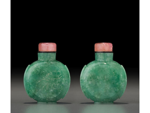 An inscribed green jadeite 'moon flask' snuff bottle with incised bird and flower decoration The bottle: 1820-1880