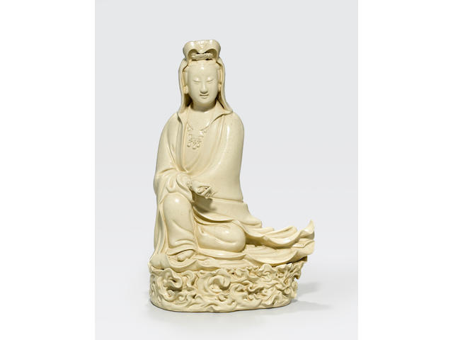 A cream-glazed figure of Guanyin