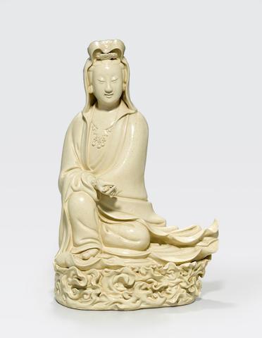A cream-glazed figure of Guanyin