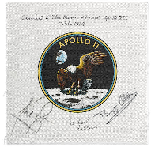 MICHAEL COLLINS' FLOWN CREW-SIGNED APOLLO 11 EMBLEM ONE OF THE VERY FEW FLOWN NEIL ARMSTRONG SIGNED MISSION ARTIFACTS A FLOWN Apollo 11 Beta cloth crew emblem, 3 ½ inches in diameter,