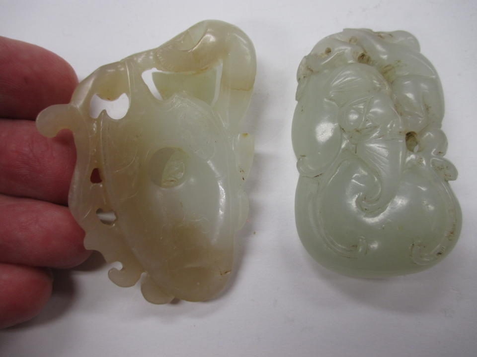 A group of nine reticulated jade animal carvings