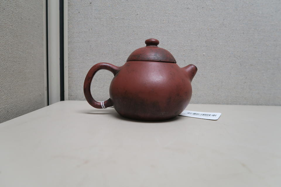A group of four Yixing pottery teapots