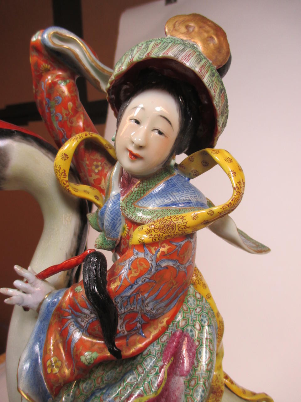 A pair of famille rose enameled figures of Immortals on cranes  Fang Hexing zao mark, Republic period