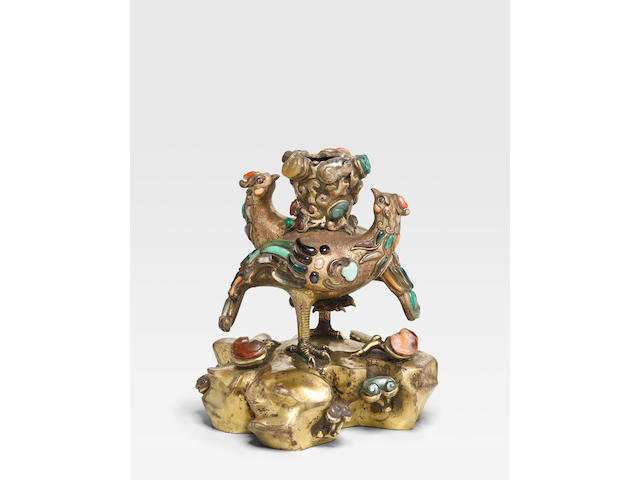 A HARDSTONE-INLAID GILT BRONZE PHOENIX-FORM CANDLE HOLDER  Qianlong period
