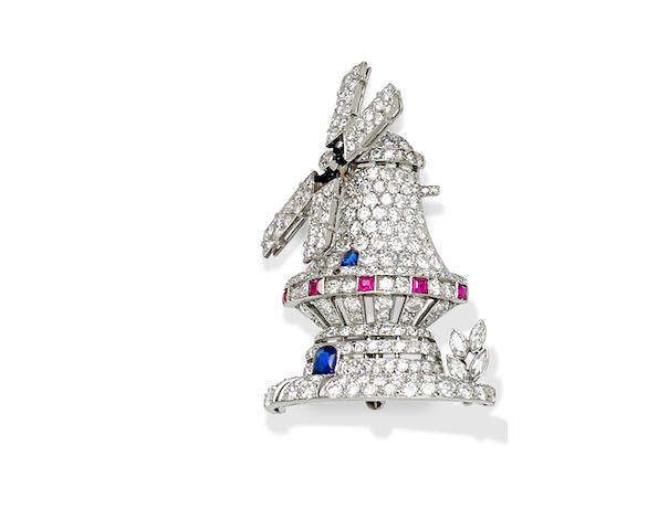 A diamond, ruby, sapphire and platinum windmill brooch