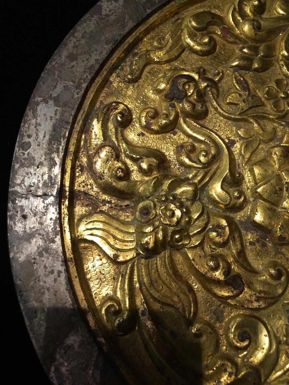 A rare gold overlay silvered bronze mirror 9th-13th century