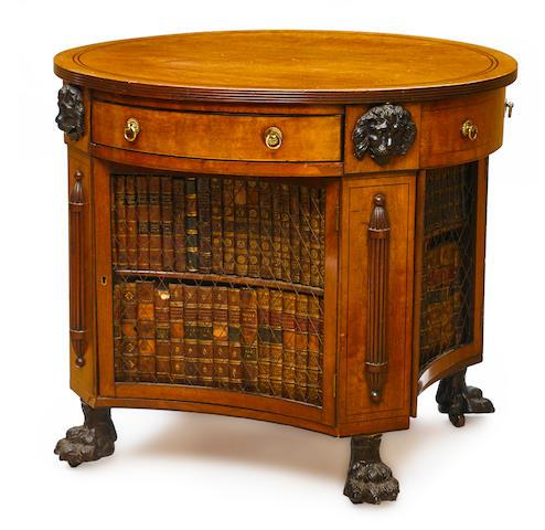 A Regency parcel ebonized inlaid mahogany library table early 19th century