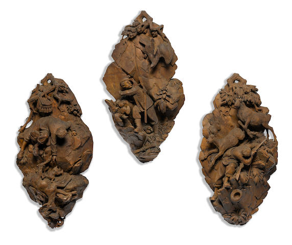 A set of three Black Forest carved lindenwood wall panels  attributed to Johann Huggler of Brienz late 19th century