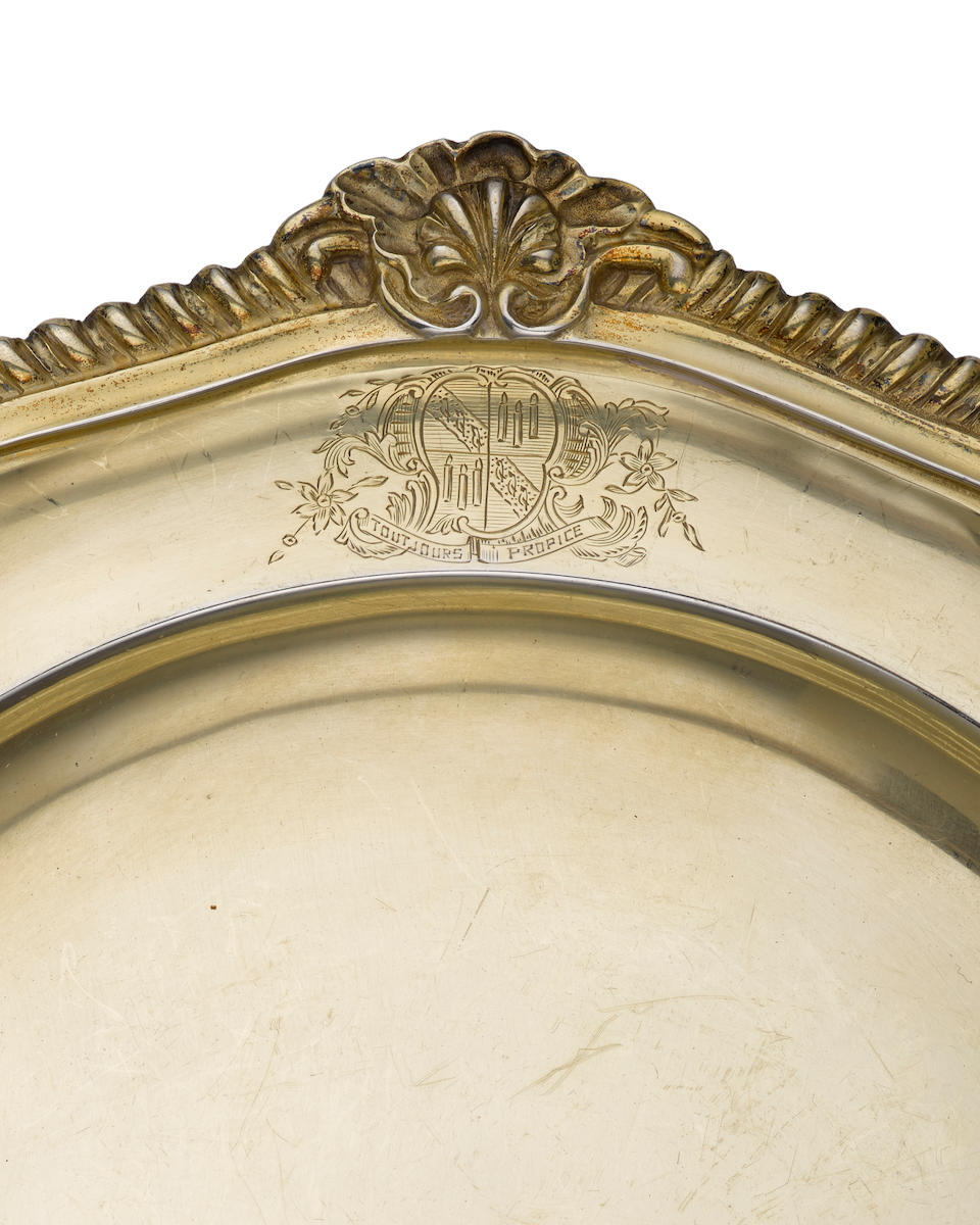 A set of eighteen George III  sterling silver-gilt dinner plates  by George Parker & Edward Wakelin, London,  1770
