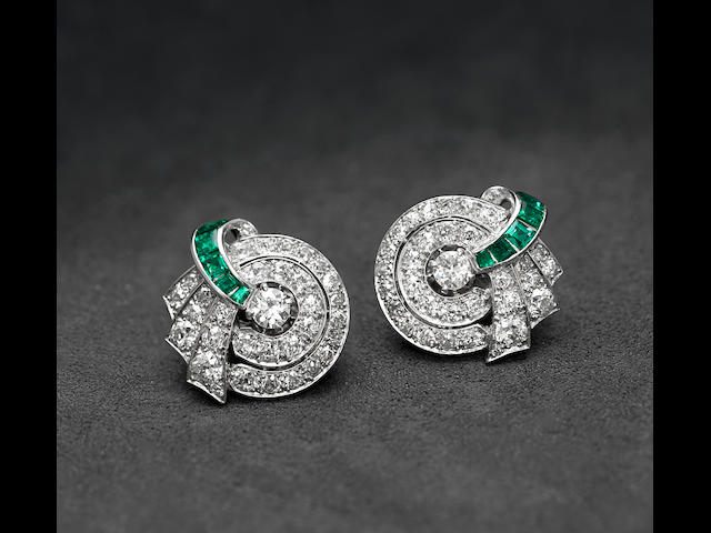 A pair of diamond, emerald and platinum ear clips