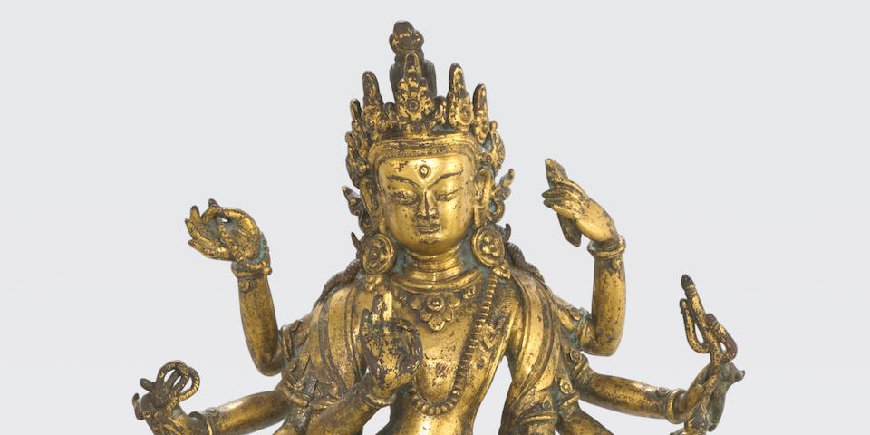 A gilt copper figure of Amoghapasa Nepalese, circa 17th century