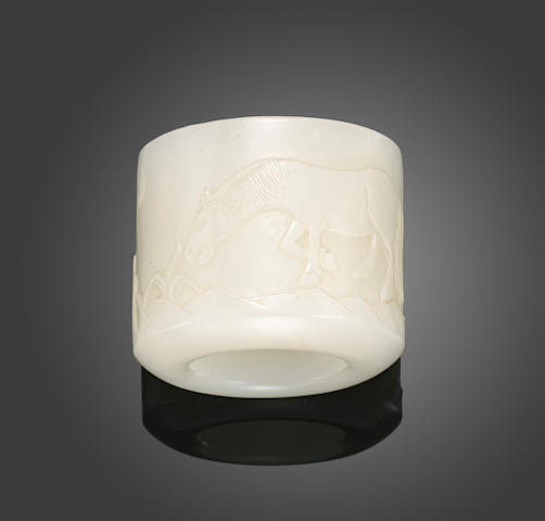 A white jade archer's ring with carved decoration Qing dynasty