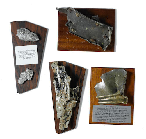 World War II: Battle of Britain. A group of twisted metal fragments, 2 ½ x 3 inches to 4 x 10 inches, 1940, mounted on matched wooden bases with engraved plaques, approximately 7 x 9 in to 5 ¾ x 11 ¾ in, in battle-damaged condition.