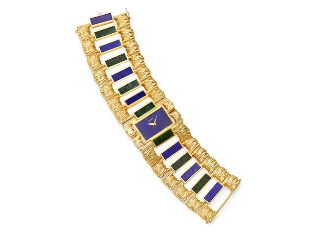 A lapis lazuli, nephrite and 18k gold integral bracelet wristwatch, Piaget,